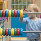 Little Boy Playing With An Abacus - VideoHive Item for Sale