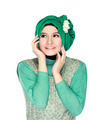 Fashion portrait of young happy beautiful muslim woman with gree