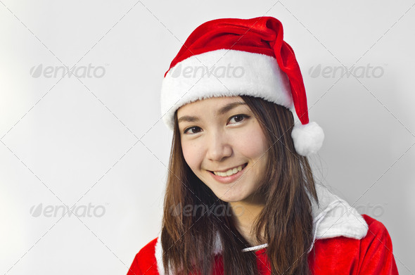 Beautiful young santa clause woman, isolated - Stock Photo - Images