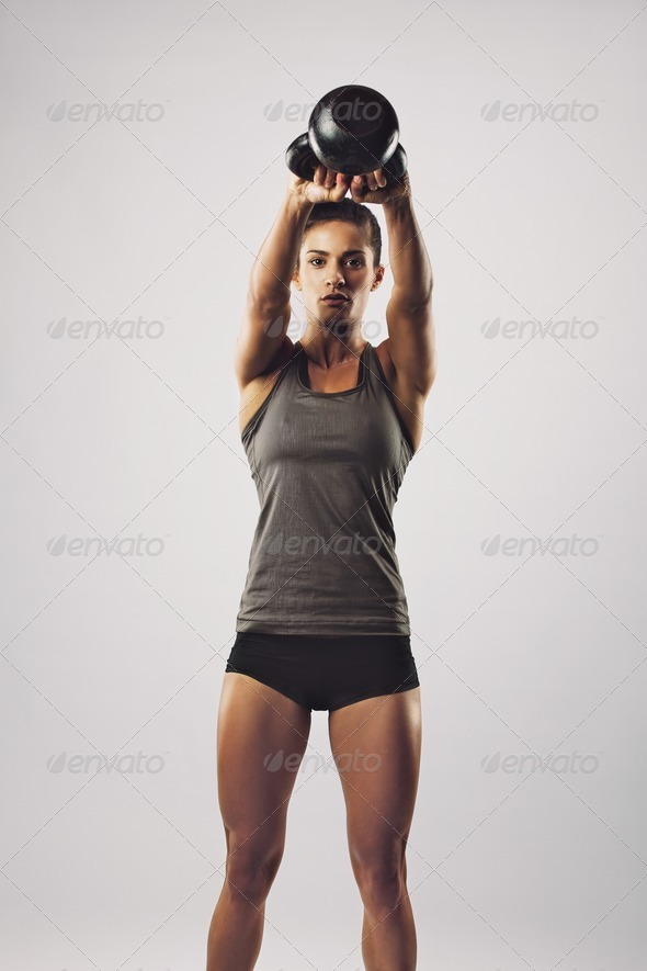 Crossfit female working out with kettle bell - Stock Photo - Images