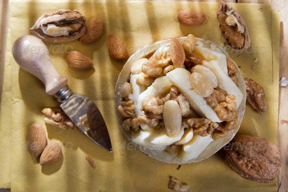 Pecorino cheese and walnuts almonds - Stock Photo - Images
