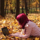 Young Girl with Laptop in Autumn Park - VideoHive Item for Sale