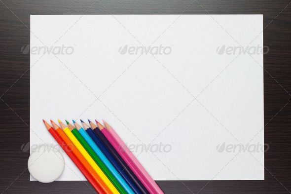 Blank Sheet Of Paper On The Table With Colorful Pencils And Rubb - Stock Photo - Images