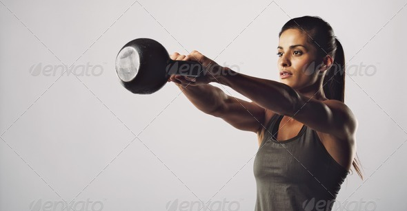 Woman exercise with kettle bell - Crossfit workout - Stock Photo - Images