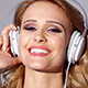 Adorable Blond Girl Listening to Music on Headphones - VideoHive Item for Sale