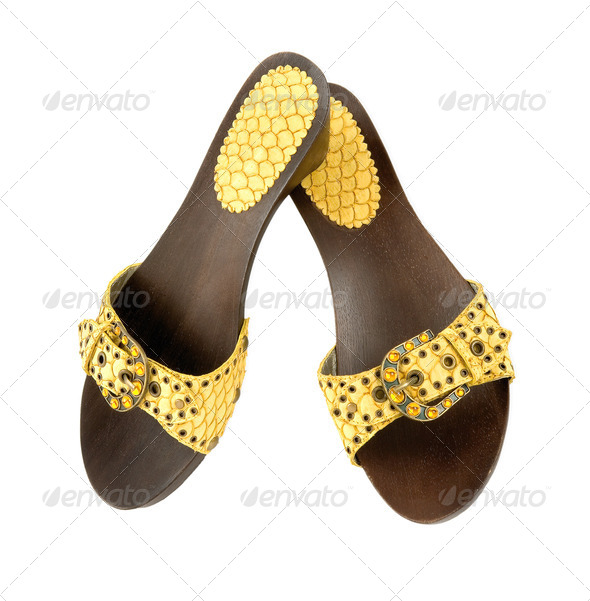 Snake leather wooden wedge yellow sandals - Stock Photo - Images