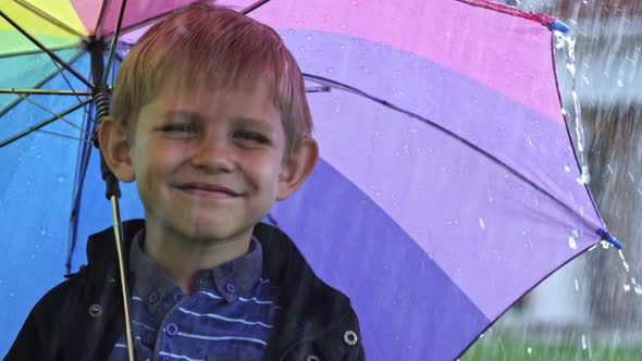 little boy with umbrella posing by pressmaster videohive