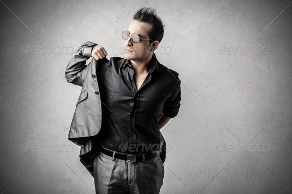 wearing his jacket - Stock Photo - Images
