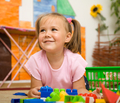 Little Girl Is Playing With Toys In Preschool - PhotoDune Item for Sale
