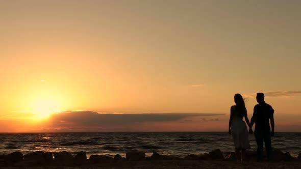 Romantic Couple In Love Enjoying Sunset On Beach By Stusya Videohive