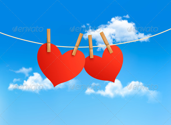 Two Hearts Hanging on a Rope in Front of a Sky - Valentines Seasons/Holidays