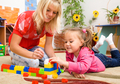 Teacher And Child Are Playing With Bricks - PhotoDune Item for Sale