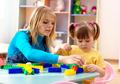 Teacher And Preschooler Play With Building Bricks - PhotoDune Item for Sale