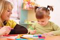 Teacher With Child In Preschool - PhotoDune Item for Sale