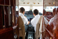 Pilots Operating Controls Of Private Jet - PhotoDune Item for Sale