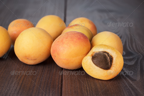 Some Fresh Apricots On Brown Table - Stock Photo - Images