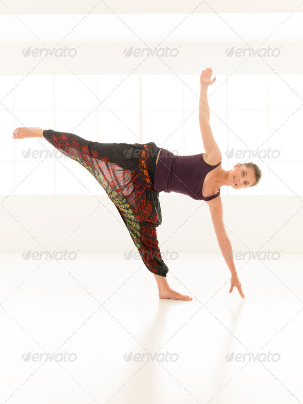 young attractive woman in yoga pose - Stock Photo - Images