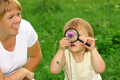 Child Looking At Flower Through Magnifying Glass - PhotoDune Item for Sale