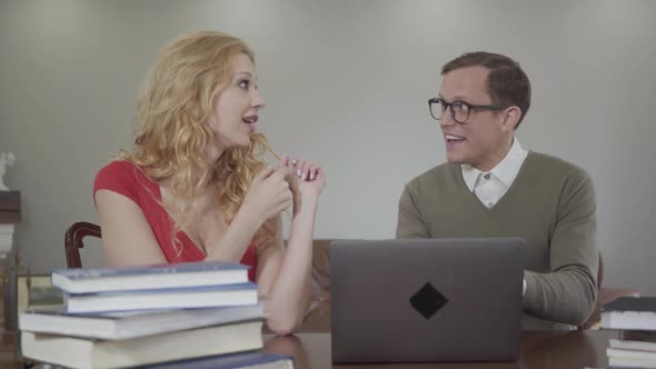 Portrait of Student with Glasses Enthusiastically Tells a Story of a Beautiful Seductive Girl