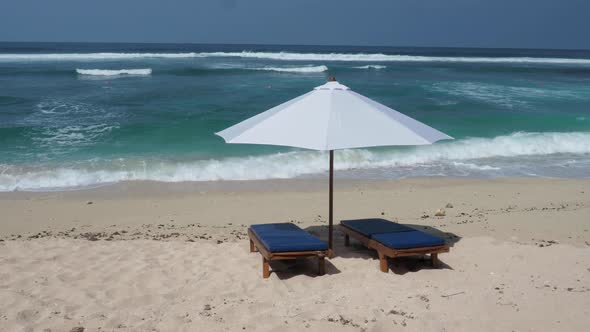 beach chair and umbrella on tropical sand beach by aburdov videohive