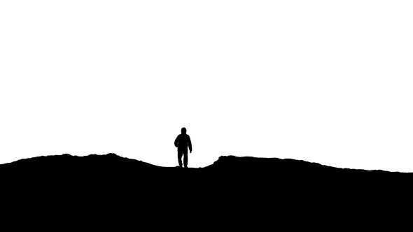 VideoHive Man Approaches Over Hill Silhouette 20263267