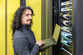 Man working with servers in data center - PhotoDune Item for Sale