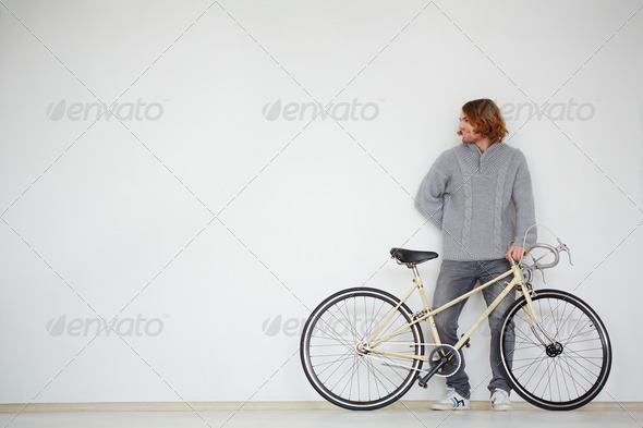 Man with bicycle - Stock Photo - Images