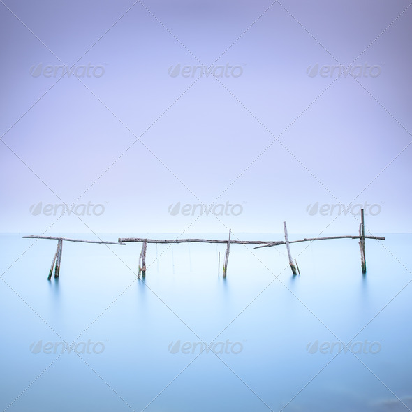 Poles and soft water on water landscape. Long exposure. - Stock Photo - Images