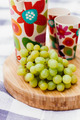 grapes and drinks on cutting board - PhotoDune Item for Sale