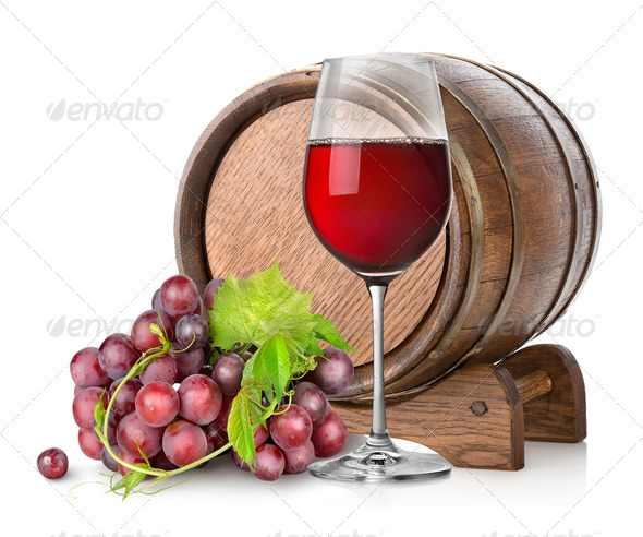Wineglass with grape and barrel - Stock Photo - Images