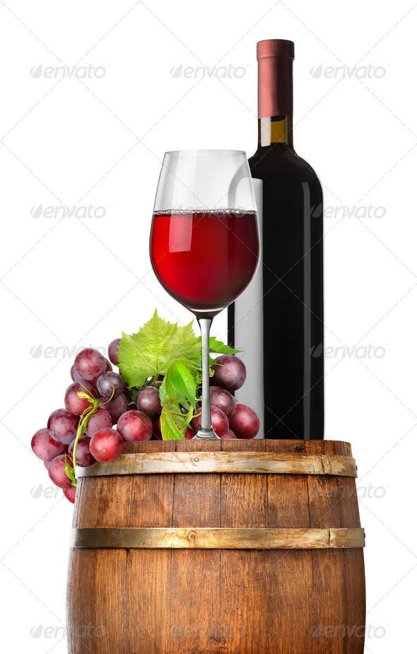 Grape and wine on a barrel - Stock Photo - Images