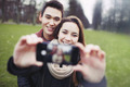 Young couple looking happy taking self portrait - PhotoDune Item for Sale