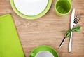 Kitchen utensils over wooden table