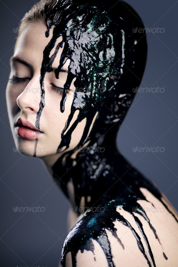 beautiful girl with flowing down the face paint - Stock Photo - Images