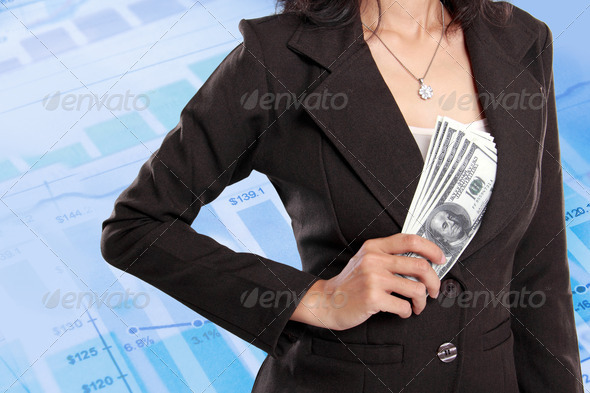 Business woman hiding money inside her jacket - Stock Photo - Images