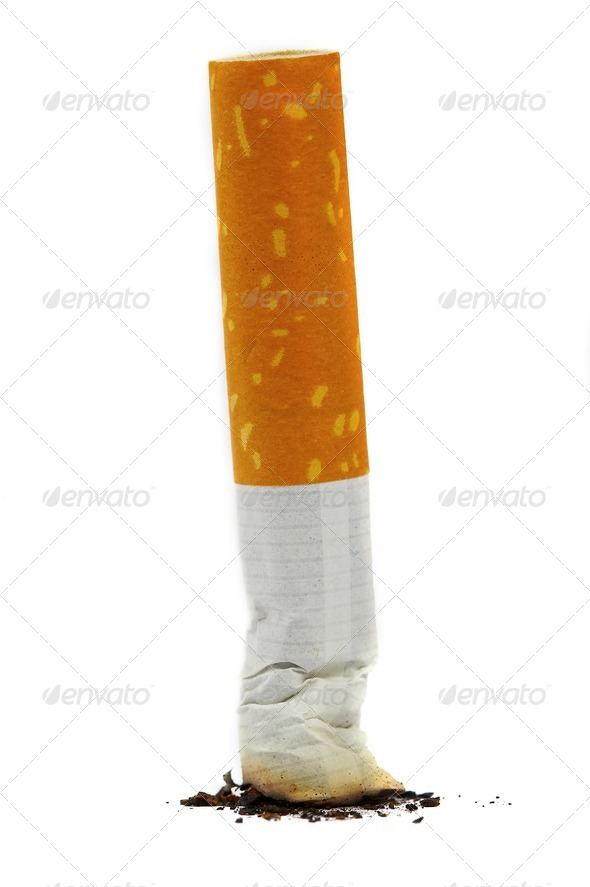 The extinguished stub of a cigarette. A bad habit. - Stock Photo - Images