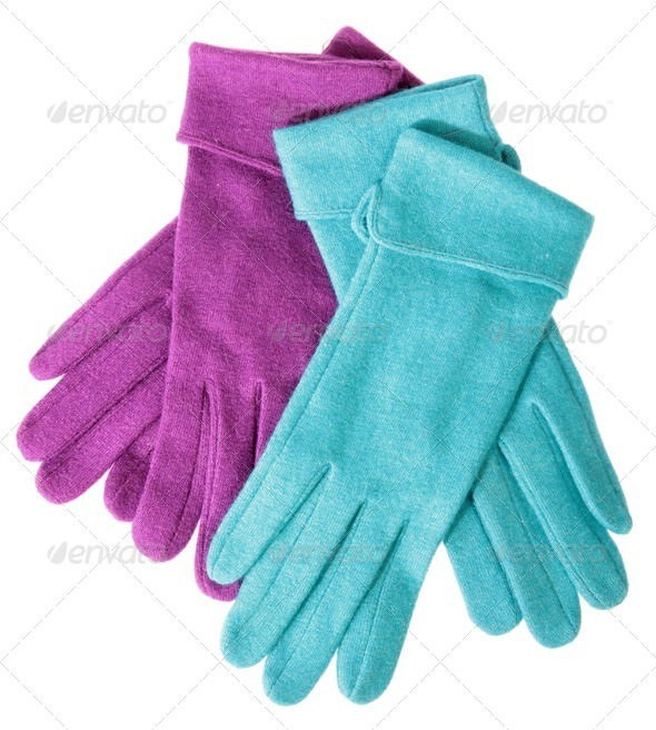 Multi-coloured woollen gloves on a white background - Stock Photo - Images