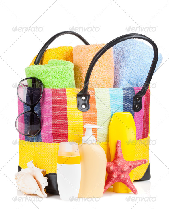 Bag with towels, sunglasses and beach items - Stock Photo - Images