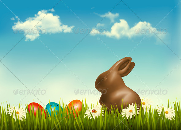 Chocolate Bunny with Easter Eggs in Grass - Seasons/Holidays Conceptual