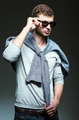 Fashion shot: handsome young man wearing jeans, shirt and sunglasses - PhotoDune Item for Sale