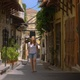 4K Woman Traveler Exploring Small Empty Streets on a Greek Island, Europe - VideoHive Item for Sale