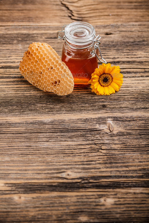 Jar of honey - Stock Photo - Images