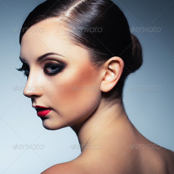 Portrait of a beautiful woman with a glamorous retro makeup - Stock Photo - Images