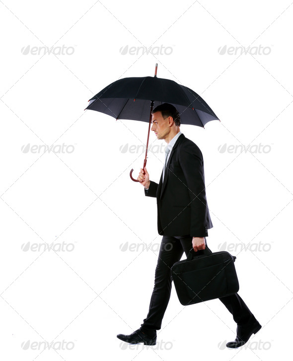 Businessman walking with umbrella and laptop bag isolated on a white background - Stock Photo - Images