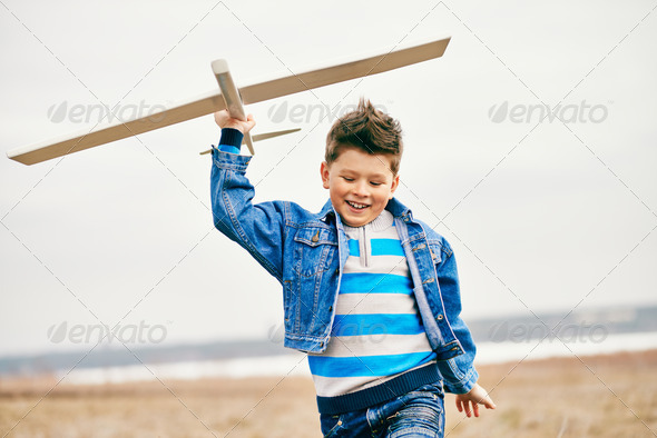 Boy with toy - Stock Photo - Images