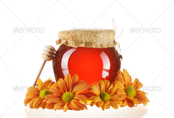 Jar of honey and dipper - Stock Photo - Images