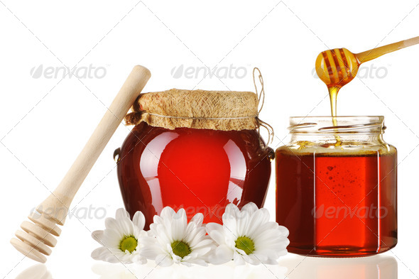 Jars of honey and dipper - Stock Photo - Images