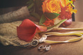 Wedding rings and accessories on chair - PhotoDune Item for Sale