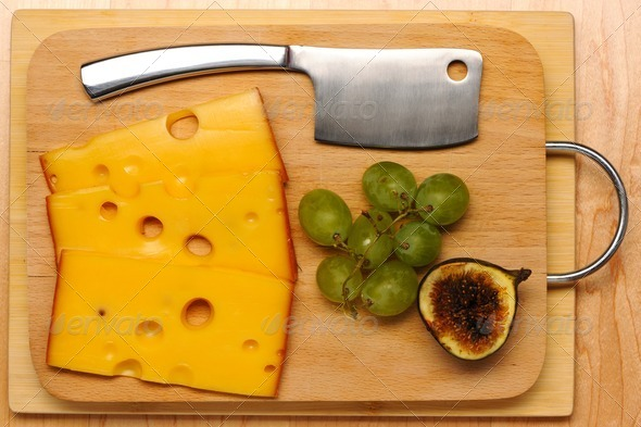 Swiss cheese and knife - Stock Photo - Images