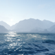 Blue Waves In The Ocean On The Background Of The Mountains And The Fog - VideoHive Item for Sale